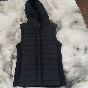 Blue puffer vest with hood and stretchy back